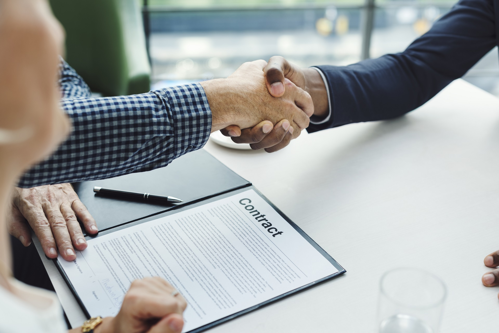 Business people shaking hands over agreement