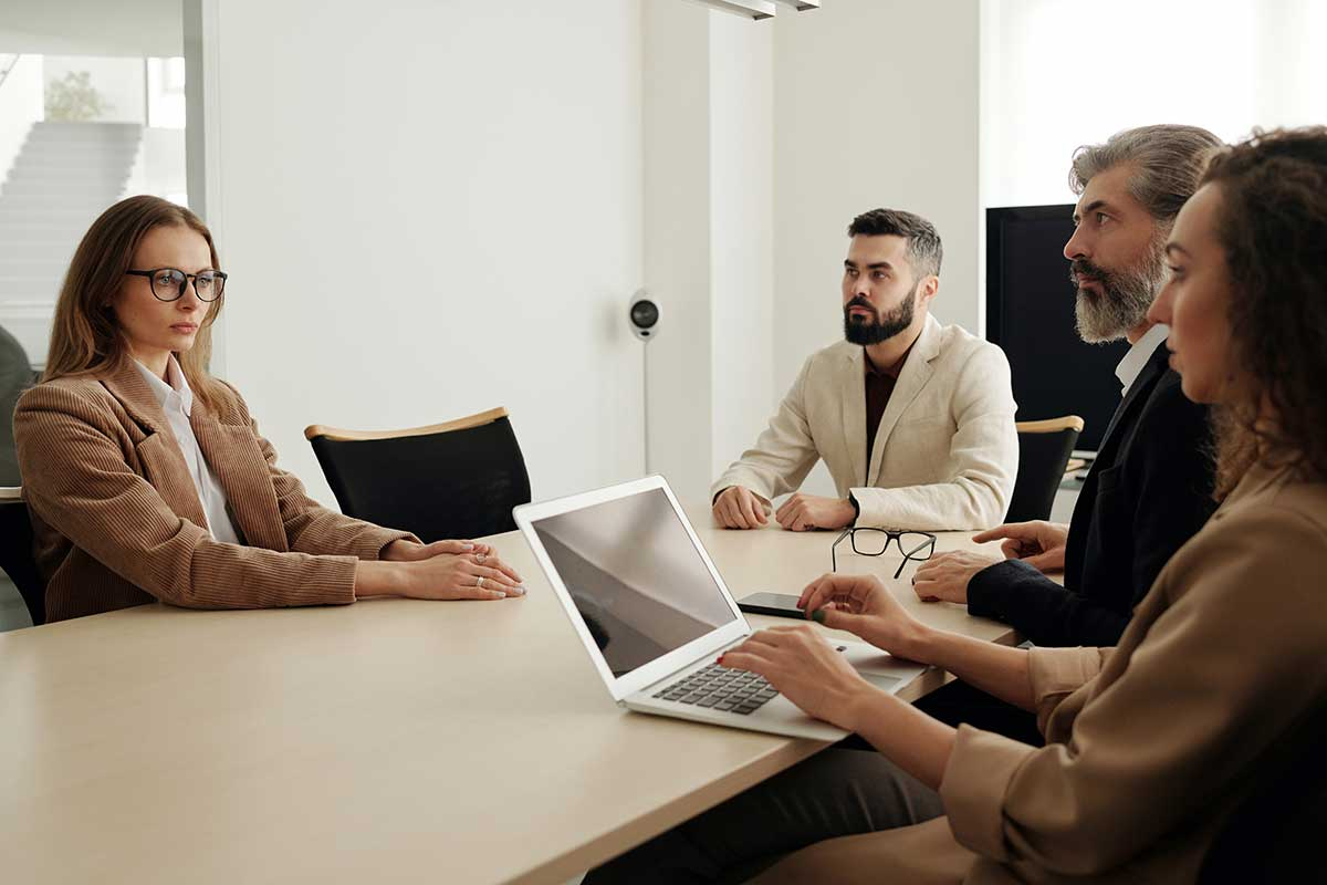 Business professionals in a conference room having a meeting