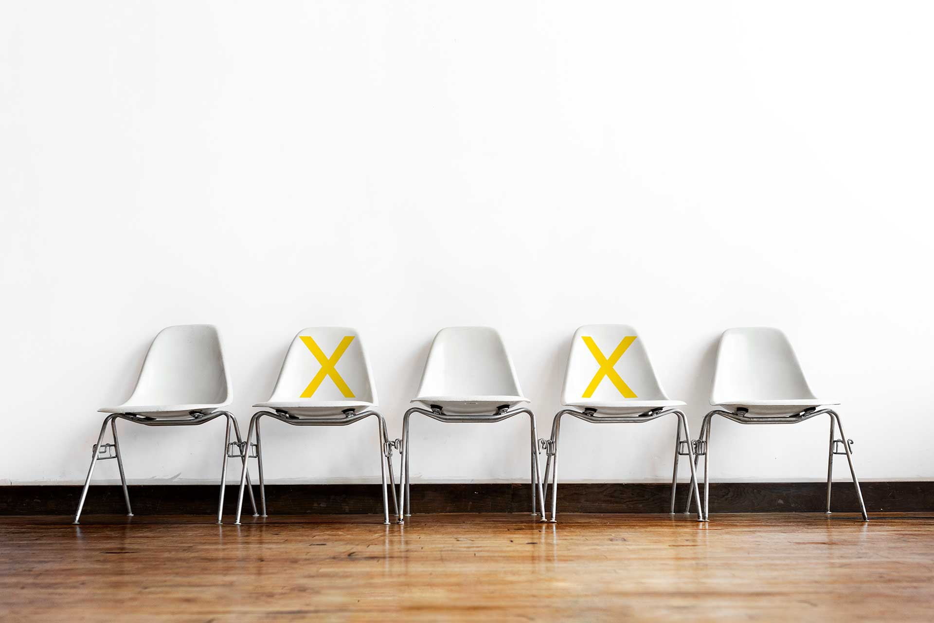 Social distancing chairs in a room